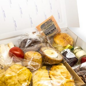 An image showing our delivered afternoon cream teas in their presentation box