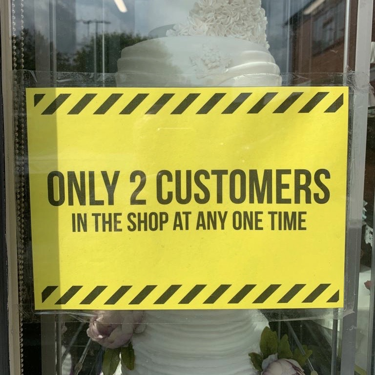 Entrance sign to the shop only 2 people at any time